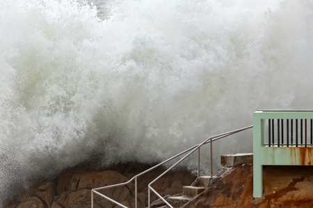 breaking in: Big detailed wave, authentic wall of water, breaking in a northern beach from Portugal. Late summer.
