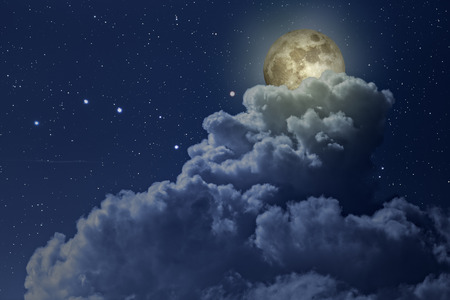 moon surface: Colorful bright night with stars and full moon arising behind a strong cloud