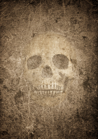 burnt: Very old burnt grunge textured paper with human skull