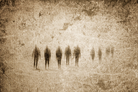 ghostly: Very old grunge paper background with zombies or ghosts. Good for halloween.