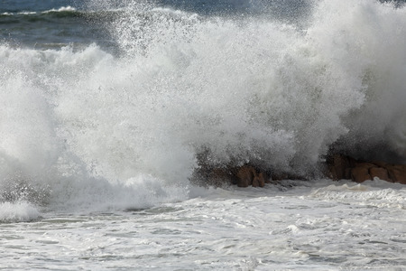 breaking in: Big detailed wave breaking in a northern beach from Portugal. Late summer.