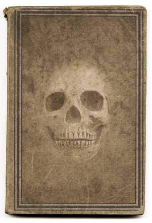 witchcraft: Very old brown witchcraft book with framed cover illustrated with a skull. Good for halloween. Stock Photo