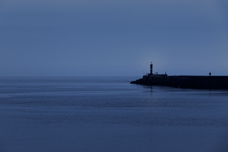 dusky: Calm sea dusk at the pier of the Ave river mouth harbor, Vila do Conde, Portugal Stock Photo