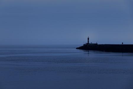 conde: Calm sea dusk at the pier of the Ave river mouth harbor, Vila do Conde, Portugal Stock Photo