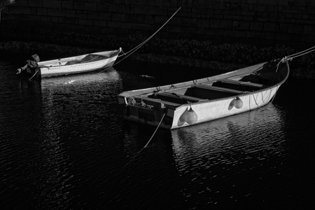infrared: Small fishing boats moored. Infrared black and whute.