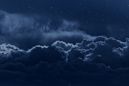 Night sky with stars and strong clouds as seen from above