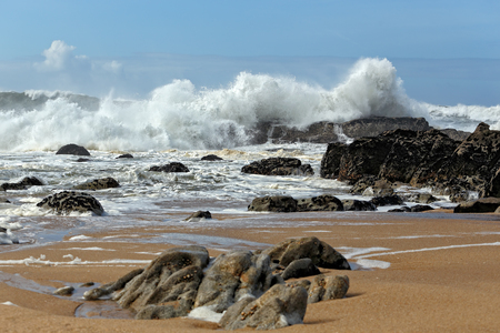 rocks water: Big waves against rocks from a northern portuguese beach in a sunny afternoon