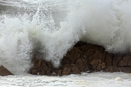 breaking in: Strong waves breaking in a rocky beach from portuguese northwest coast