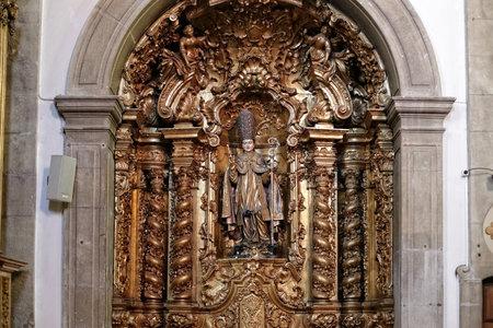 christian altar: Porto, Portugal - March 4, 2015: Side altar of St. Nicholas church, dedicated to St. Nicholas, the true Christian father christmas.
