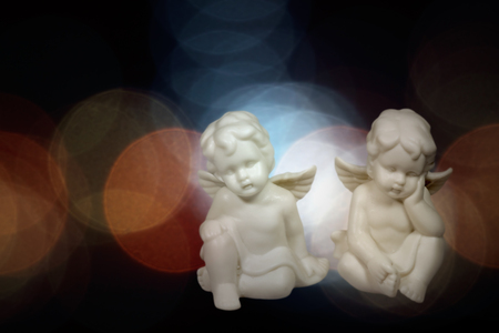 christmas angels: Soft christmas angels against flare background. Used digital filters. Stock Photo
