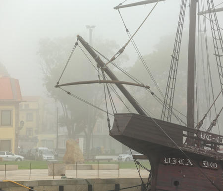 ave: Vila do Conde; Portugal: September 25; 2015: Replica of caravel from the time of discoveries, moored at the mouth of the River Ave, Vila do Conde, a former place of wooden boat construction.