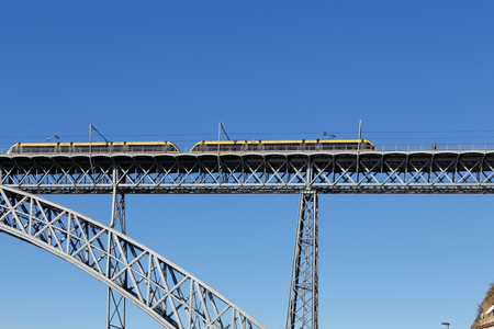 brige: Porto; Portugal - March 4; 2015: Metro old iron brige Dom Luis against a beautiful typical blue sky