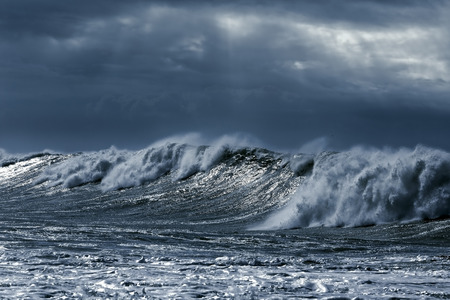 Big stormy waves aproaching the portuguese coast. Toned blue 스톡 콘텐츠