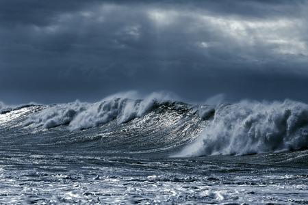 Big stormy waves aproaching the portuguese coast. Toned blue Archivio Fotografico