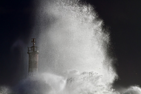 dark sky: Big splashing wave closeup in a stormy evening. North of Portugal.