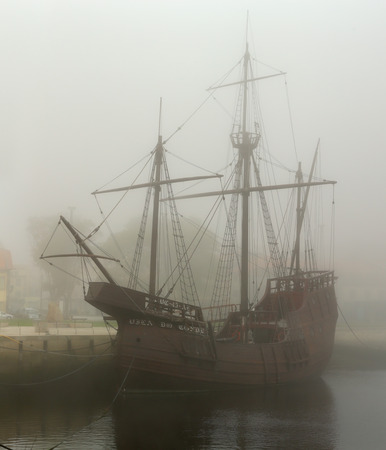 ave: Vila do Conde, Portugal - September 25, 2015: Replica of caravel from the time of discoveries, moored at the mouth of the River Ave and his marina, Vila do Conde, a former place of wooden ship construction. Editorial