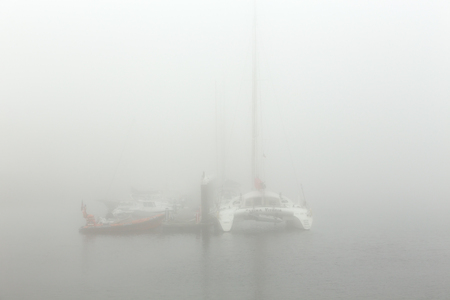 ave: Vila do Conde, Portugal - September 25, 2015: Ave river marina in a foggy afternoon