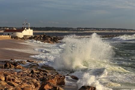 ave: Sunny stormy seascape from  Nossa Senhora da Guia (Our Lady of Guidance), Ave river mouth, Vila do Conde, Portugal Stock Photo