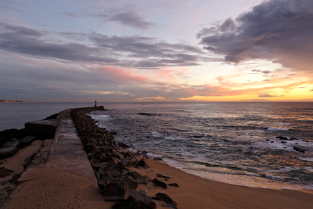 conde: Ave river mouth at dusk, almost night, with interesting colorful cloudy sky. Vila do Conde, north of Portugal.