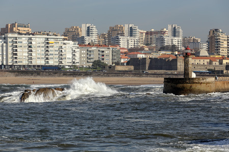senhora: Porto, Portugal - November 11, 2015: Pier, lighthouse, beach Senhora da Luz and part of the seafront of Porto as seen from the sea