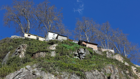 underprivileged: Shacks and trees on a hill near the Douro river against deep blue sky, Porto, Portugal Stock Photo