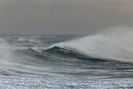 Ocean windy waves spraying. Portuguese coast in Autumn.