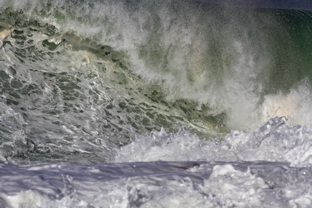 breaking in: Detailed big Atlantic wave breaking in a rocky beach from the north of Portugal Stock Photo