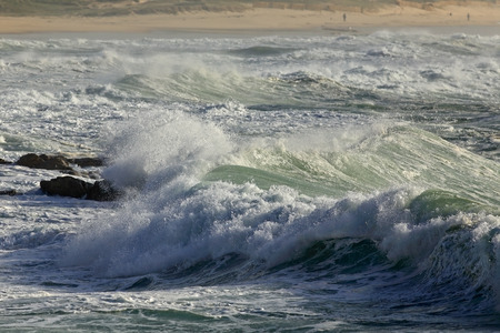 breaking: Stormy waves breaking against the portuguese coast Stock Photo