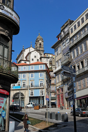 Porto, Portugal - March 23, 2015: One of the central squares of the city of Porto, seeing one of its ubiquitous churches, against the typical deep blue sky