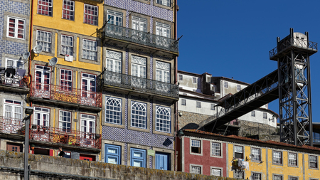 public houses: Porto, Portugal - March 4, 2015: Colorful Oporto Ribeira, Unesco site, seeing typical houses and the old public elevator, Elevador da Lada Editorial
