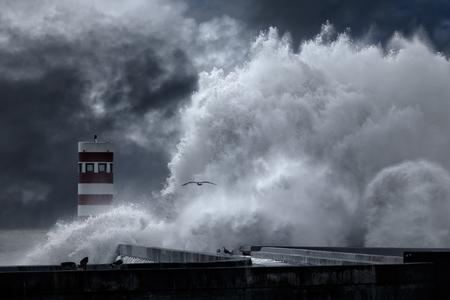enhanced: Big atlantic stormy waves over pier and beacon. Enhanced sky.