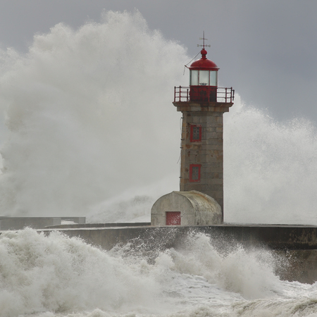 old pier: Huge Atlantic waves over Douro river old pier lighthouse in a stormy afternoon with beautiful light