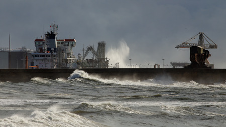 unloading: North wall of Leixoes harbor, north of Portugal, in wind and rough sea afternoon seeing a boat unloading chemicals