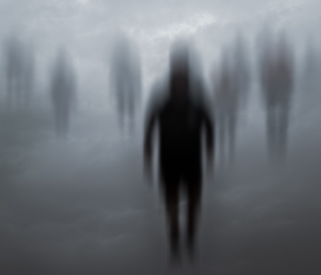 Blurred mysterious people walking in a weird background Stock Photo