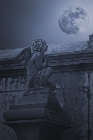 angel cemetery: Stone angel from an old European cemetery in a full moon night