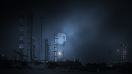 Part of a big oil refinery in a foggy full moon night