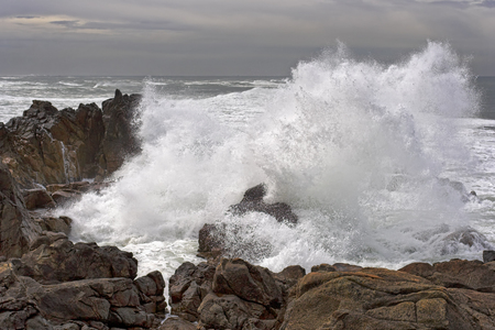 Big wave against little Cape of Labruge in the north of Portugal Stock Photo