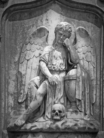 angel cemetery: Old cemetery sad angel sculpture. Used infrared filter.