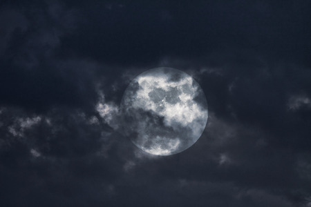 interesting: Illustration of an interesting full moon in a cloudy night Stock Photo