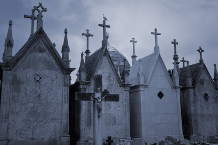 hallowmas: Old european cemetery with tombs in form of chapel with crosses Stock Photo