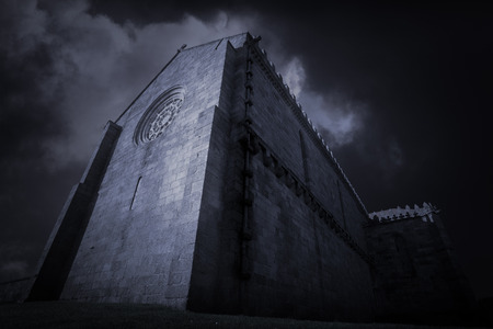 conde: Gothic church of the monastery of Santa Clara in vila do Conde from the XIV century (1318) in Vila do Conde, near Porto. Photo composition with clouds of a winter late evening.Personal view. Stock Photo
