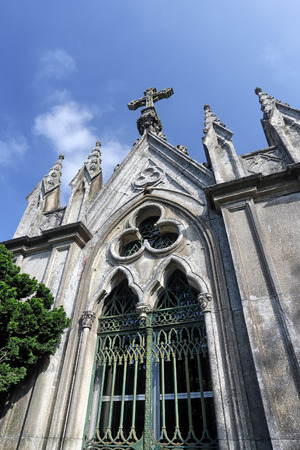 Old granite traditional portuguese middle class family vault in the form of chapel Stock Photo