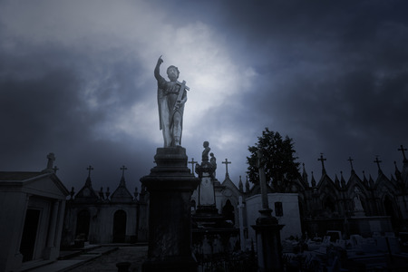 old church: Overcast sad cemeteryb with an angel statue on the foreground