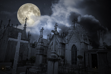 hallowmas: Old european cemetery in a cloudy full moon night Stock Photo
