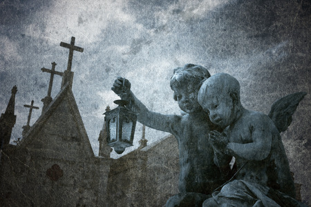 hallowmas: Grunge old cemetery angels background.