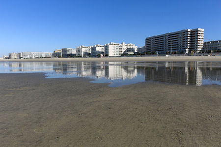 wide  wet: Matosinhos, neighbor city of Porto, northern Portugal, reflected in the wet sand of its sea beach Stock Photo