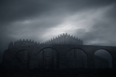 christian halloween: Medieval abbey and aqueduct of Vila do Conde, Portugal, on a misty evening Stock Photo