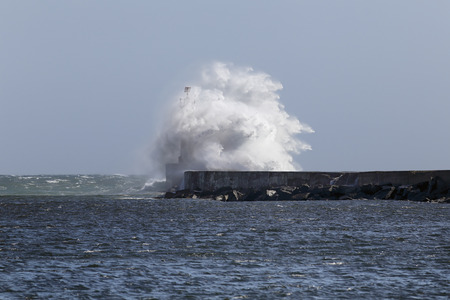 ave: Ave river mouth, north of Portugal, during spring stormy north winds with big wave against pier and beacon