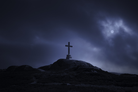 Dramatic: Mysterious cross in a hill against a cloudy full moon night