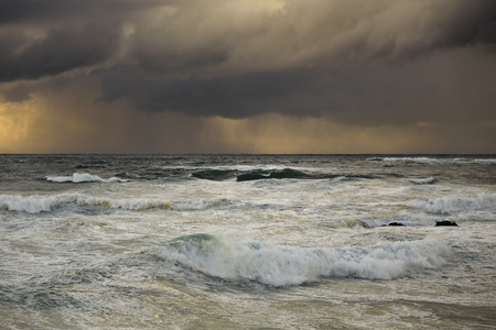 Portuguese coast at sunset before rain and storm